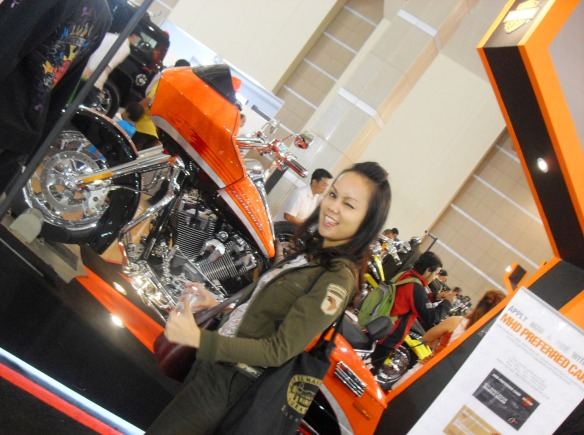 In front of the Orange Harley! It's Cool!